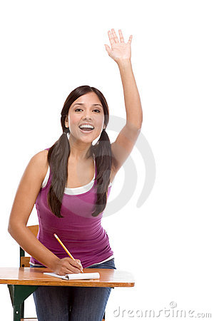 Hispanic schoolgirl raised hand in class