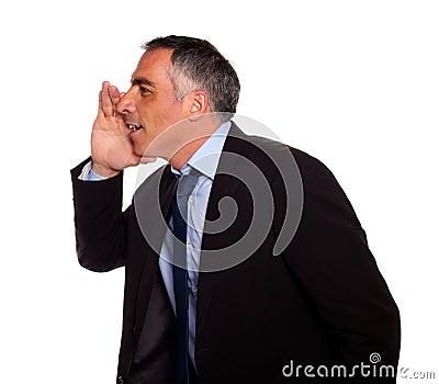 Hispanic senior businessman whispering