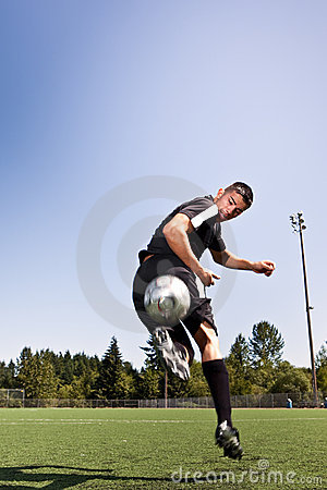 Free Hispanic Soccer Or Football Player Kicking A Ball Stock Images - 10968124