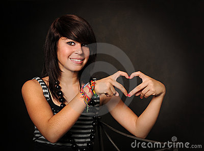 Hispanic Teen Forming Heart