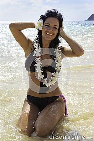 Hispanic woman in bikini at the beach