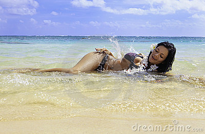 Hispanic woman in bikini at the beach Stock Photo