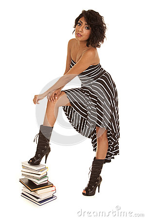 Hispanic woman books stand on with one foot