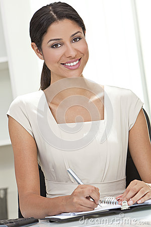 Hispanic Woman Businesswoman Writing in Office