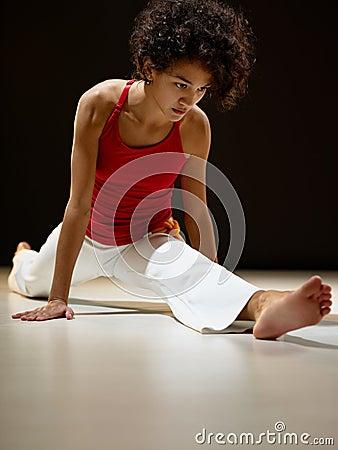 Hispanic woman doing leg splits