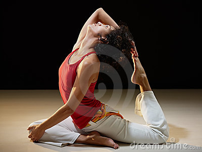 Hispanic woman doing stretching and yoga