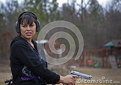 Hispanic Woman Firing Pistol