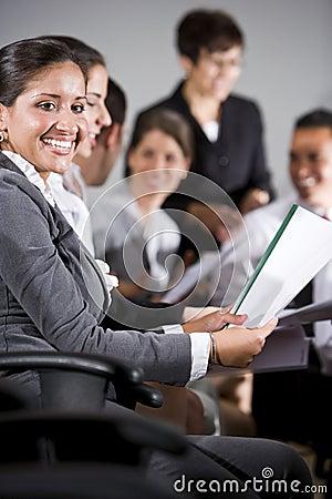 Hispanic woman in group presentation