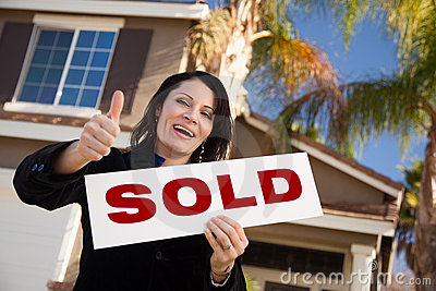 Hispanic Woman Holding Keys & Sold Sign