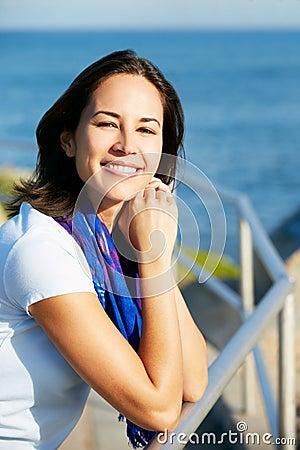 Hispanic Woman Looking Over Railing At Sea