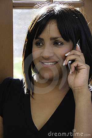 Free Hispanic Woman On Cell Phone Stock Images - 7847404