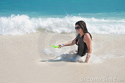 Hispanic Woman Playing in the Beach