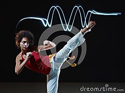 Hispanic woman playing capoeira martial art
