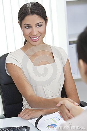 Hispanic Woman Shaking Hands in Office
