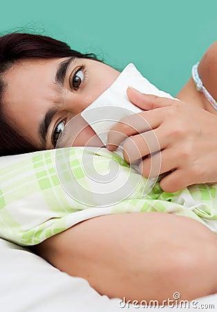 Hispanic woman sick with the flu