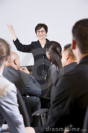 Free Hispanic Woman Speaking To Group Of Businesspeople Stock Images - 14685944