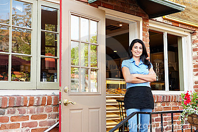 Hispanic Woman standing outside bakery