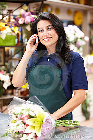 Hispanic woman working in florist