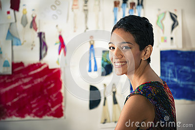 Hispanic young woman working as fashion designer
