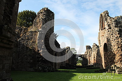 Historic abbey ruins with sunlight and shadows