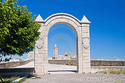 Historic arch with Cathedral in background.