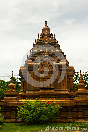 Historic red stupa in thailand, against blue sky