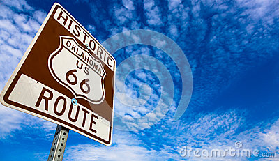 Historic Route 66 road sign on a blue sky