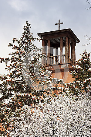 Historic Santa Fe Church Steeple Stands over snow
