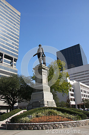 Historic statue and cityscape