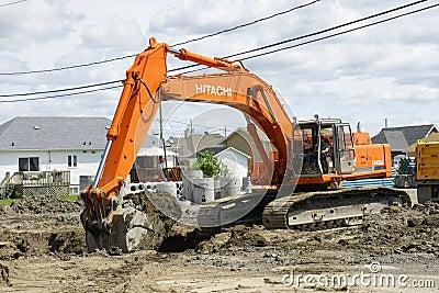 Hitachi orange digger Editorial Stock Image