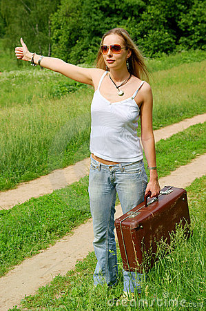 Hitchhiker with old suitcase
