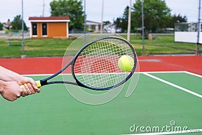 Hitting a backhand at tennis