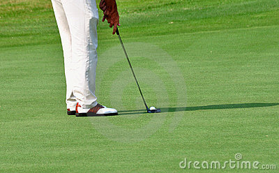 Hitting the golf