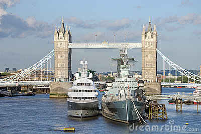 HMS Belfast, luxury yacht moored by Tower Bridge