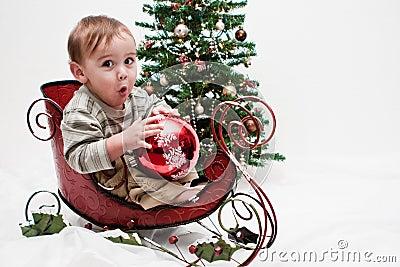 Ho Ho Ho toddler in little Christmas sleigh