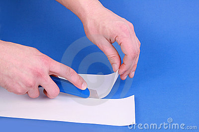 Hobby knife cutting paper