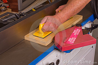 Hobby woodworker using a jointing machine