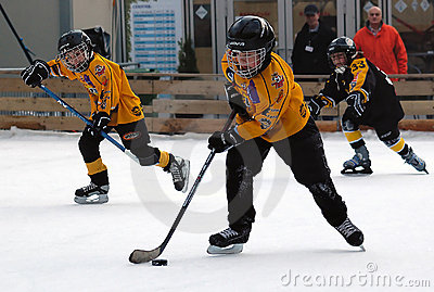 Hockey players in action with puck Editorial Photo