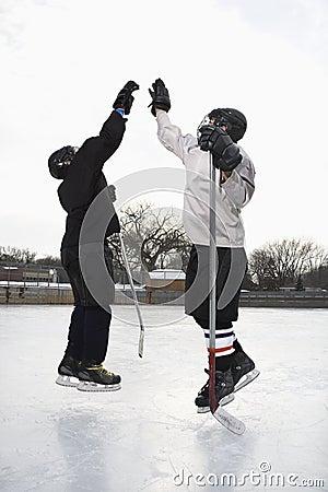 Hockey players high fiving.