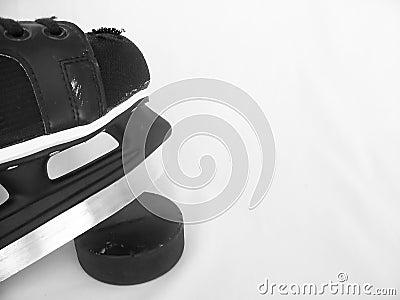 Hockey Skate and Puck
