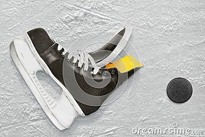 Hockey skates and puck