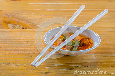 Hoisin & Chopsticks - Chopsticks resting on a small white bowl o