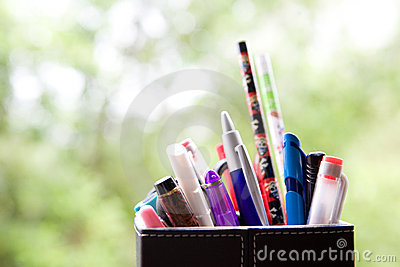 Holder full of pens and pencil