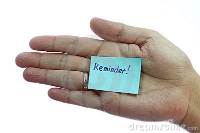 Holding blank notepaper with reminder