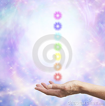 Free Holding Chakra Energy In Open Hand Stock Photo - 43275130