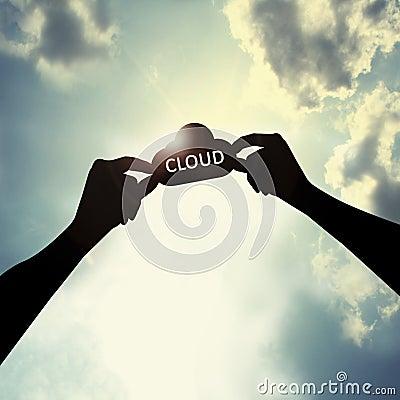Holding cloud shape in sky