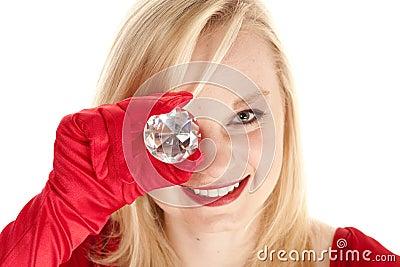 Holding gem to eye