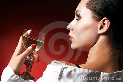 Holding a glass of wine