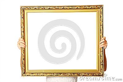 Holding golden frame