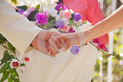 Holding hands with floral background